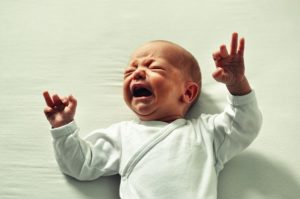 Baby crying in bed