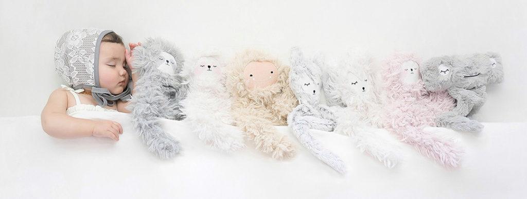 sleeping-baby-with-stuffed-animals